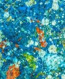 Färgrika målarfärgdroppar på golvet Fotografering för Bildbyråer