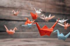 Färgrika origamipapperskranar Fotografering för Bildbyråer