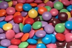 färgrika sötsaker för bakgrund Arkivfoto