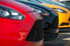 Färgrikt materiel för bilåterförsäljare Arkivfoton
