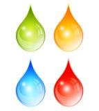 Färgvattendroppar Arkivbild