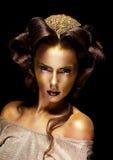 Förgylld guld- framsida för kvinna - teaterlyxsmink Royaltyfri Fotografi