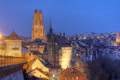 Fribourg skyline at night, Switzerland. Skyline composition at night of the city of Fribourg in Switzerland. The only tower of the Saint Nicholas Cathedral Royalty Free Stock Photo