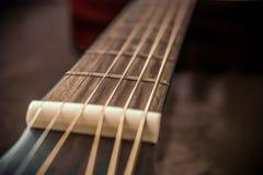 Fricções e cordas da guitarra Imagens de Stock Royalty Free