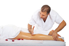 Friction massage to woman's leg stock photography