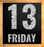 Friday 13, белый текст мела на черной доске Стоковые Фото