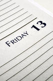Friday the 13th. Personal planner opened to Friday the 13th stock photos