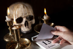 Friday 13th on a calendar. With candles and a creepy skull Stock Images
