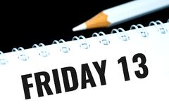 Friday 13, black text in personal organizer. With white pencil Stock Photos