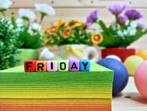 Friday. Colorful cube letters on sticky note block. stock photos
