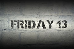 Friday 13 GR. Friday 13 stencil print on the grunge white brick wall royalty free stock photography