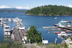 Friday Harbor on San Juan island. In Washington state with yachts docked at pier and view of Orcas island in the background royalty free stock image
