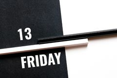 Friday 13, monochrome concept. With paper sheets and pencils Stock Photo
