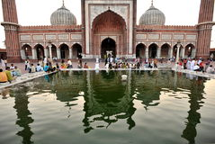 Friday mosque reflection. People doing a prayer in Friday Mosque Old Delhi, India. September 2009 Stock Photos