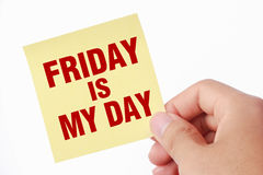 Friday is my day. Hand with Friday is my day note is isolated on white background royalty free stock photography