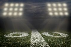 Free Friday Night Lights Football Game On Football Field Fifty Yard Line Background Stock Photos - 160397983