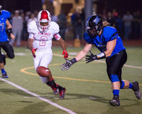 Friday Night Lights High School Football Fumble. Recovery Stock Image