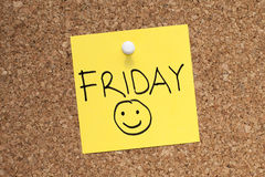 Friday. Note pinned on cork noticeboard stock images