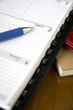 Friday on planner. Blue pen point to friday on planner Stock Image