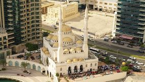 Friday prayer at a mosque in Dubai. Time lapse of Friday prayer Mohammed Bin Ahmed Almulla Mosque in Dubai Marina stock footage