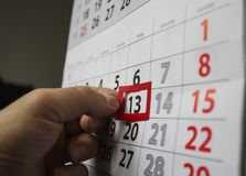 Friday 13th. Red square reminder on calendar on friday 13th|unluck|bad luck|superstition stock photography