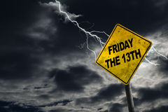 Friday the 13th Sign With Stormy Background. Friday the 13th sign against a stormy background with lightning and copy space. Dirty and angled sign adds to the Royalty Free Stock Photo