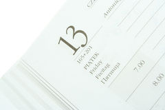 Friday thirteenth. Close up of a calendar page with Friday thirteenth Royalty Free Stock Photography