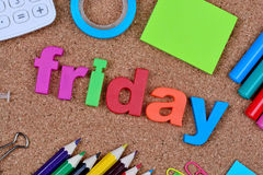 Friday word on cork background Royalty Free Stock Images