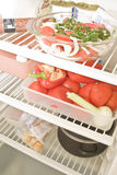 In the fridge. Healthy, organic ingredients in an open fridge Royalty Free Stock Images