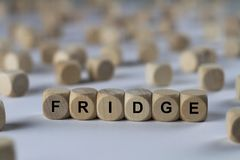 Fridge - cube with letters, sign with wooden cubes Royalty Free Stock Image