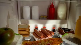 Fridge filled with junk food, unhealthy nutrition concept, high calorie meal. Stock photo stock photo