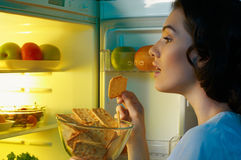 Fridge with food. A hungry girl opens the fridge Stock Photo