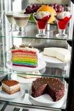 Fridge with fruit and cake Stock Photography