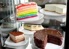 Fridge with fruit and cake Royalty Free Stock Photography
