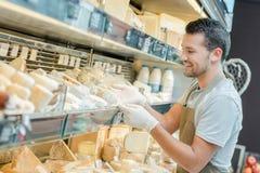Fridge full of cheese. Man royalty free stock photos
