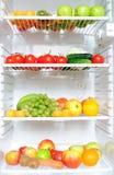 Fridge full of fruit and vegetables. Refrigerator with fruit and vegetables assortment Royalty Free Stock Photo