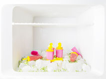 Fridge with ice creams, ice blocks and frozen peas Royalty Free Stock Photography