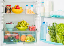 Fridge inseide with food. Fridge inseide filled with different fresh food Stock Images