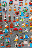 Fridge magnet souvenirs representing Serbian national culture and costumes. Fridge magnet souvenirs with traditional symbols of Serbian culture Royalty Free Stock Photo