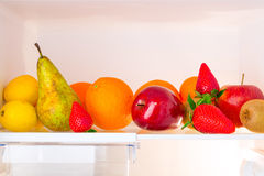 Fridge shelf with fruits Royalty Free Stock Images