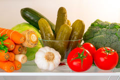 Fridge shelf with vegetables. Fridge shelf full of healthy vegetables Stock Image