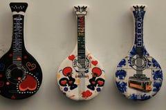 Fridge souvenir magnets imitating portuguese fado guitar. Fado Portugal words written on them stock images