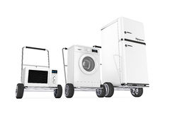 Fridge, Washing Machine and Microwave Oven over Hand Carts. 3d R Royalty Free Stock Photo