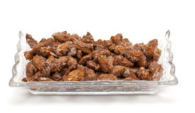 Fried almonds with sugar and cinnamon Stock Photos