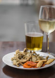 Fried anchovies, white wine and beer at a street bar Stock Photo