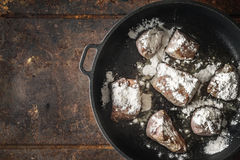 Fried angus beef with flour in the  pan top view Royalty Free Stock Photo