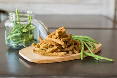 Fried appetizer plate with green beans stock photography
