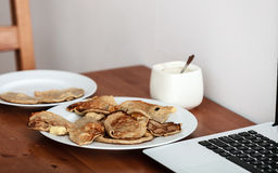 Fried apple in pancake dough or apple fritters with icing sugar Royalty Free Stock Photos