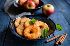Fried apple rings in a batter. Delicious fried apple rings in a batter royalty free stock photos