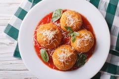 Fried arancini rice balls with tomato sauce closeup. horizontal Stock Photo